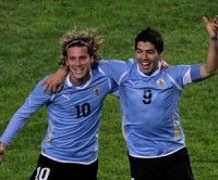 Diego Forlán y Luis Suárez