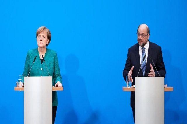 Angela Merkel y el líder del Partido Socialdemócrata, Martin Schulz