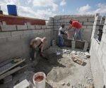 Brigada #1 del contingente Ñico López Trabajan junto a los propietarios de viviendas afectadas por el tornado, municipio de Regla, La Habana, Cuba.
